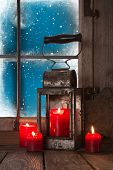 Christmas Atmosphere: Four Red Burning Candles In The Window.