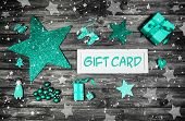 image of mint-green  - Christmas gift card for a xmas coupon decorated in mint green wood and white color - JPG