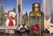 Christmas Window Decoration With Old Toys And A Lantern With A Red Candle.