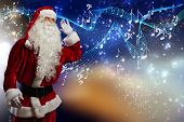 Santa Claus enjoying sound of distant music