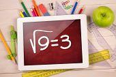 Composite image of digital tablet on students desk showing math equations