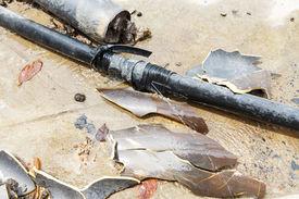 picture of leak  - Close up plumbing leaks on concrete floor - JPG