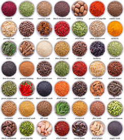 image of cardamom  - large collection of different spices and herbs isolated on white background - JPG