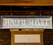 stock photo of funeral  - Vintage Funeral Service cartel made of wood - JPG