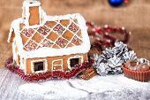 picture of gingerbread house  - traditional gingerbread house on a background of Christmas decorations - JPG
