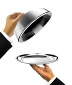 Waiter Holding Platter With Open Cover