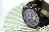 foto of money  - Watch and money concept for business investment or time is money - JPG