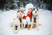 stock photo of sled-dog  - Beautiful woman with green eyes - JPG