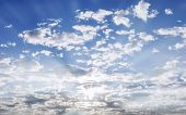 Blue Sky With Clouds And Sun Lighting