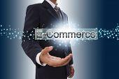 Businessman hand showing e-commerce button