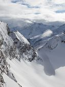 image of view from space needle  - vertical landscape with beautiful high mountain peaks and clean fluffy snow - JPG