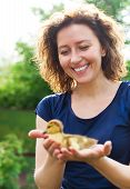 Woman Holding Little Yellow Duckling In Her Hands