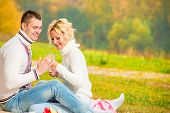 Heterosexual Couple Relaxing Cheerfully In The Park