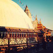 Praying Wheels Around Swayambha Stupa On A Sunset - Vintage Filter.