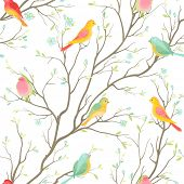 Seamless vector pattern with colored birds.