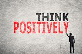 Asian businessman write text on wall, Think Positively