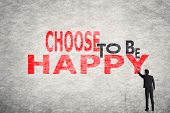 Asian businessman write text on wall, Choose to be Happy