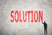 Asian businessman write text on wall, Solution