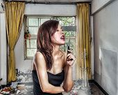 Chinese Woman In Abandoned Apartment About To Lick A Knife