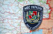 Illustrative editorial.Chevron of Ukrainian Police in Lugansk region. Former Ukraine.At present time Novorossia.With map of Lugansk. At January 10,2015 in Kiev, Ukraine