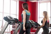 Sporty Girls Train On Treadmill