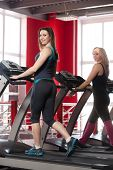 Sporty Girls Walk On Treadmill