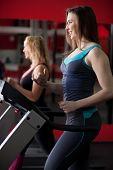 Sporty Girl Running On Treadmill