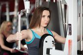 Girl Exhales While Doing Exercises With Weights On Training Apparatus
