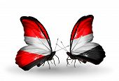 Two Butterflies With Flags On Wings As Symbol Of Relations Austria And Yemen