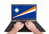 Hands Working On Laptop, Marshall Islands