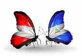 Two Butterflies With Flags On Wings As Symbol Of Relations Austria And Nicaragua