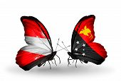 stock photo of papua new guinea  - Two butterflies with flags on wings as symbol of relations Austria and Papua New Guinea - JPG