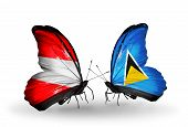 Two Butterflies With Flags On Wings As Symbol Of Relations Austria And Saint Lucia