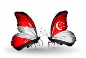 Two Butterflies With Flags On Wings As Symbol Of Relations Austria And Singapore
