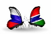 Two Butterflies With Flags On Wings As Symbol Of Relations Russia And  Gambia