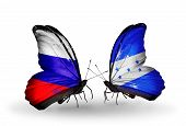 Two Butterflies With Flags On Wings As Symbol Of Relations Russia And Honduras