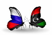 Two Butterflies With Flags On Wings As Symbol Of Relations Russia And Libya
