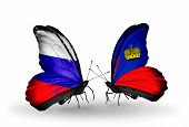 Two Butterflies With Flags On Wings As Symbol Of Relations Russia And Liechtenstein