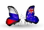 Two Butterflies With Flags On Wings As Symbol Of Relations Russia And  New Zealand