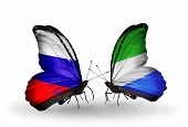Two Butterflies With Flags On Wings As Symbol Of Relations Russia And Sierra Leone