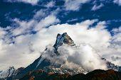 Peak Machapuchare over clouds, Nepal
