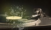 Turntable playing classical music with icon drawn instruments concept on background