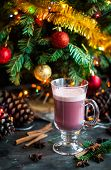 Christmas Winter Sweet Hot Alcohol Drink Mulled Red Wine Glintwine With Egg Cream And Spices. Vertic