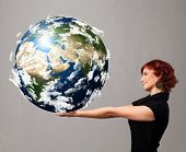 pic of cartographer  - Pretty young girl holding 3d planet earth - JPG
