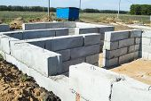 stock photo of cornerstone  - Initial works on construction of the house - JPG