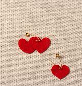 Felt red hearts on the burlap