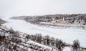 Winter Dull Landscape With Frozen Volga River In Staritsa Town