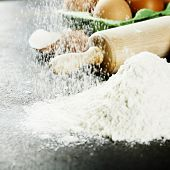 baking background with raw eggs, rolling pin and flour