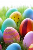 Green Grass With Many Colorful Easter Eggs For Seasons Greetings