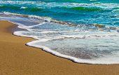 foamy wave of the sea, sandy beach, Greece
